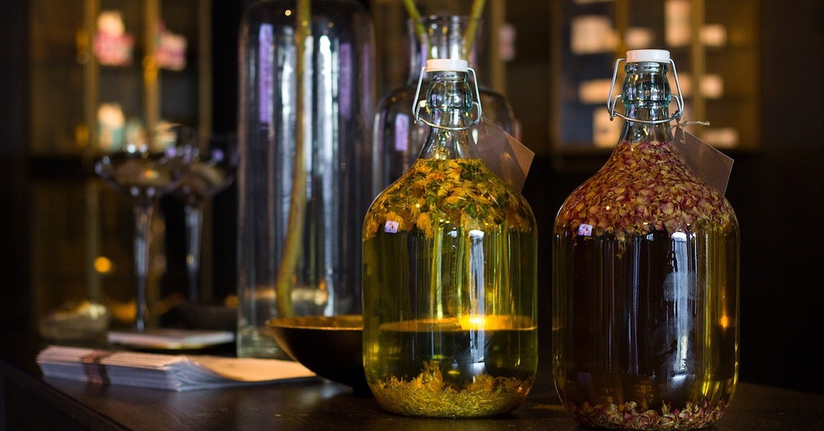 Bottles of oils with herbs; Consultations with Nikki Haak